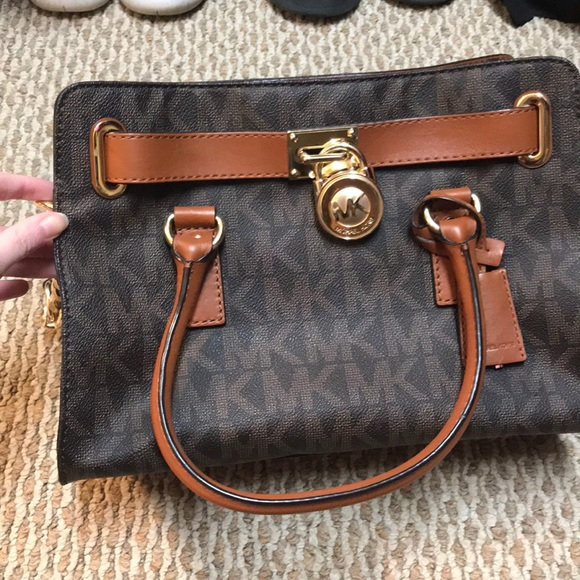37caf78181aa Brown Michael kors purse with gold chain strap.